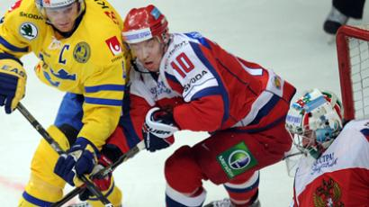 Sweden's Steffam Kronwall (L) vies with Russia's Sergey Moziakin (C) in front of the Russia's goalie Konstantin Barulin's (R) net during Channel One Cup hockey match, the event of the Euro Hockey Tour in Moscow on December 13, 2012 (AFP Photo / Alexander Nemenov)