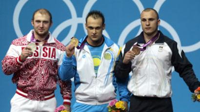 Russia's Aleksandr Ivanov (L), Ilya Ilyin of Kazakhstan and Moldova's Anatoli Ciricu on the 94kg category weightlifting podium (RIA Novosti / Valeriy Melnikov)