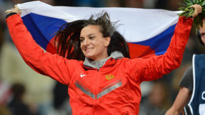 Russia's Elena Isinbaeva celebrates her third place in the women's pole vault final at the athletics event of the London 2012 Olympic Games on August 6, 2012 in London. (AFP Photo / Jewel Samad)