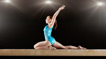 Gymnast performing on a balance beam
