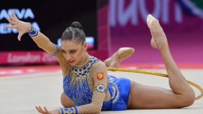 Russia's Evgeniya Kanaeva performing with the hoop in the qualification phase of the individual rhythmic gymnastics competition at the London Olympic Games 2012 (RIA Novosti / Vladimir Pesnya)