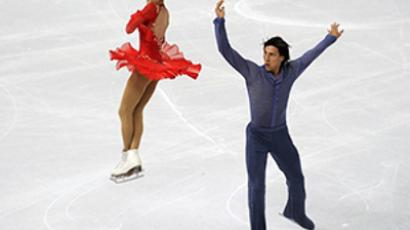 Yuko Kavaguti and Alexander Smirnov of Russia compete during the Pairs Free Skating at the 2010 ISU World Figure Skating Championships on March 24, 2010 in Turin, Italy