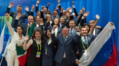 A delegation from Kazan rejoicing over the city's victory in the right to host the World Water Sports Championship-2015 at the FINA Congress in Shanghai (RIA Novosti/Alexander Vilf)