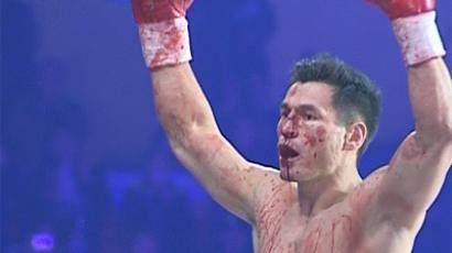 Batu Khasikov celebrates Gago Frago win. (Still from RT video)