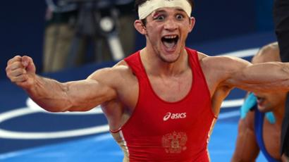 Russia's Alan Khugaev reacts after defeating Mohammad Gaber Ibrahim of Egypt during their London 2012 Olympic Games 84kg Greco Roman Wrestling Final match at the Excel Centre in London on August 6, 2012 (AFP Photo / Manan Vatsyayana)