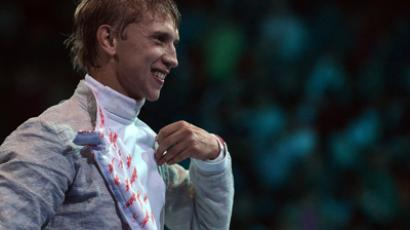Russia's Nikolay Kovalev celebrates his victory over Germany's Nicolas Limbach at the end of their Men's Sabre fencing event at the London 2012 Olympics (AFP Photo / Alberto Pizzoli)
