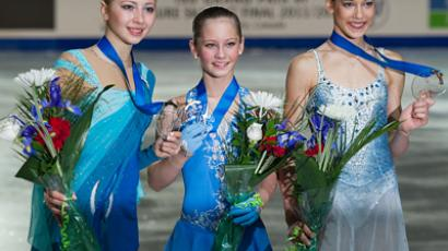 The awards ceremony for the Russian winners of the singles free skating competition at the Junior Grand Prix Final of Figure Skating in Quebec, Canada. From left: Polina Shelepen (silver), Yulia Lipnitskaya (gold), and Polina Korobeynikova (bronze) (RIA Novosti /  Alexander Vilf)