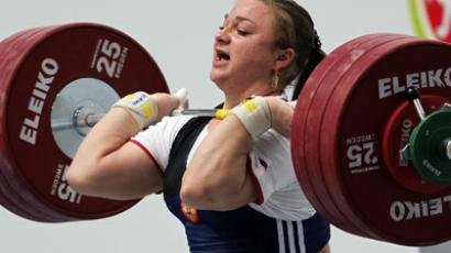 Russia's Tatyana Kashirina, weight class 75 kg, competes in snatch lift.  (RIA Novosti/Roman Kruchinin)