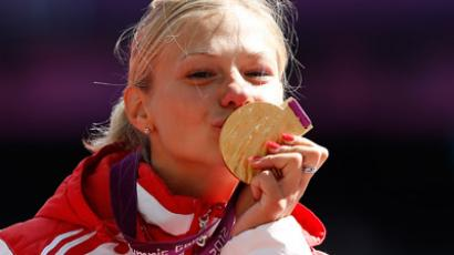 Russia's Margarita Goncharova poses with the gold Paralympic medal  (AFP Photo / Ian Kington)