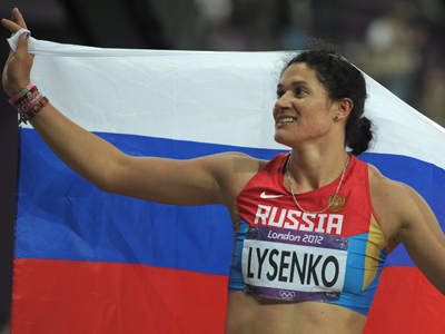 Lysenko wins hammer throw with Olympic record