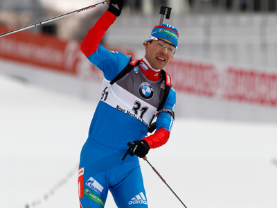 Andrey Makoveev of Russia crosses the finish line to win the World Cup biathlon men's 20 km individual event in Nove Mesto. (Reuters / Petr Josek)