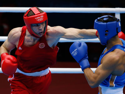 Russia's Egor Mekhontcev (L) fights Kazakhstan's Adilbek Niyazymbetov during their Men's Light Heavy (81kg) gold medal boxing match at the London Olympics.(REUTERS / Damir Sagolj)