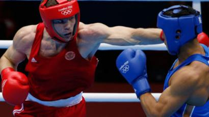 Russia's Egor Mekhontcev (L) fights Kazakhstan's Adilbek Niyazymbetov during their Men's Light Heavy (81kg) gold medal boxing match at the London Olympics.(REUTERS / Damir Sagolj)