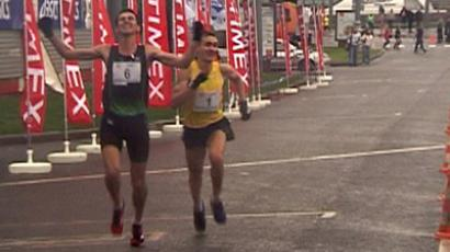 Fedor Shutov and Mikhail Kulkov crossing the finish line at the Moscow International Peace Marathon (Video still)