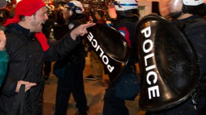 Demonstrators confront police as they protest against tuition hikes in downtown Montrea (Reuters / Christinne Muschi)