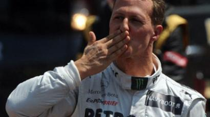 German driver Michael Schumacher blows a kiss in the parc ferme after the qualifying session at the Circuit de Monaco (AFP Photo / Dimitar Dilkoff)