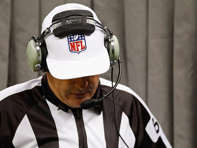 Referee Don King reviews a play between the Kansas City Chiefs and the New Orleans Saints at the Mercedes-Benz Superdome on September 23, 2012 in New Orleans, Louisiana.   (AFP Photo / Getty Images / Chris Graythen)