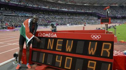 Kenya's David Lekuta Rudisha poses by the record board after winning the men's 800 final at the athletics event during the London 2012 Olympic Games.(AFP Photo / Adrian Dennis)