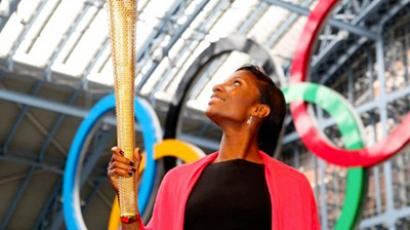 Denise Lewis, former British Olympic heptathlete, poses for pictures with the newly unveiled 2012 London Olympic Torch (AFP Photo / Geoff Caddick)