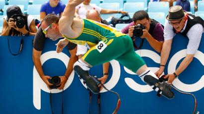 Photographers take pictures as Oscar Pistorius of South Africa competes in his men's 400 metres.(REUTERS / Kai Pfaffenbach)