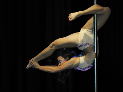 Colombia's Kely Alvarez competes in the Miss Pole Dance South America (AFP Photo / Juan Mabromata)