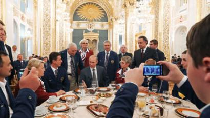 Russian President Vladimir Putin (center in the background) at his meeting with the Russian Paralympic national team in the Kremlin.(RIA Novosti / Mikhail Klimentyev)