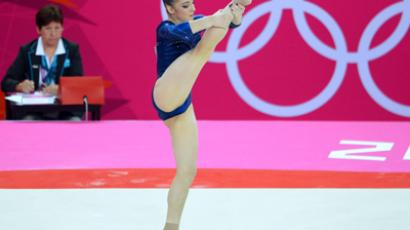 Russia's gymnast Aliya Mustafina performs on the floor at the London 2012 Games  (AFP Photo / Miguel Medina)