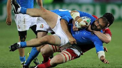 Salvatore Perugini of Italy is tackled by Alexksandr Voytov of Russia during the 2011 Rugby World Cup match (AFP Photo / Marty Melville)