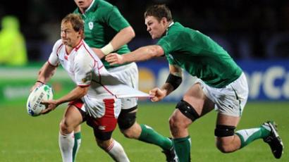 Russia's scrum-half Alexander Yanyushkin (L) runs with the ball during the 2011 Rugby World Cup pool C match Ireland vs Russia at Rotorua International Stadium on September 25, 2011 (AFP Photo / PHILIPPE LOPEZ)