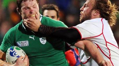 Ireland's flanker Donnacha Ryan (L) vies with Russia's prop Sergey Popov during the 2011 Rugby World Cup  (AFP Photo / Philippe Lopez)
