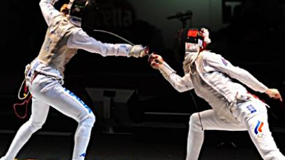 Italy's Valentina Vezzali fights with Russia's Larisa Korobeynikova during the final of the Women's Team Foil competition at the 2011 World Fencing Championships in Catania. (AFP Photo / Giuseppe Cacace)