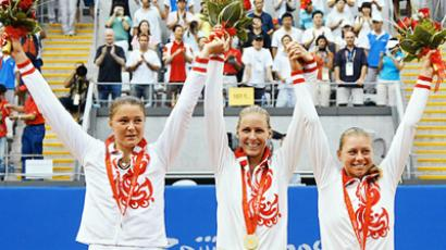 Russian tennis players Dinara Safina (L) (silver), Elena Dementieva (gold) and Vera Zvonareva (bronze) taking all three places at the podium in Beijing 2008 (RIA Novosti / Anton Denisov)