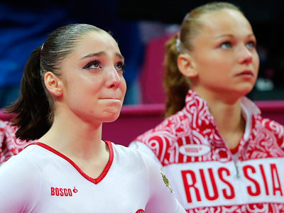 Russia's Aliya Mustafina (L) reacts next to team mate Maria Paseka (Reuters / Mike Blake)