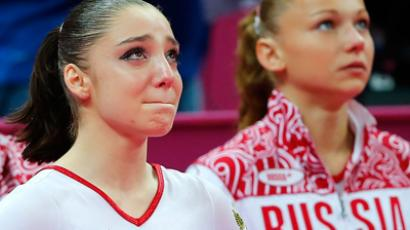 Russia's Aliya Mustafina (L) reacts next to team mate Maria Paseka (Reuters / Mike Blake)