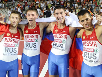 Spain, Barcelona : Russian team celebrates its victory in the men's 4x400m relay final at the 2010 European Athletics Championships at the Olympic Stadium in Barcelona on August 1, 2010. (AFP Photo / Pierre-Philippe Marcou)