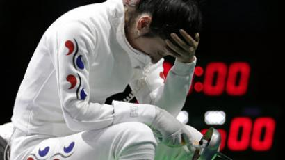 South Korea's Shin A Lam reacts after being defeated by Germany's Britta Heidemann (not seen) during their women's epee individual semifinal fencing competition at the ExCel venue at the London 2012 Olympic Games July 30, 2012. (Reuters/Max Rossi)