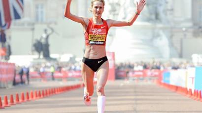 Liliya Shobukhova of Russia crosses the finish line to come in second during the women's section of the London marathon April 17, 2011 (AFP Photo / Getty Images)