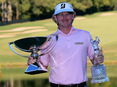 Brandt Snedeker poses with the FedExCup and TOUR Championship trophies after his three stroke victory clinched the cup during the final round of the TOUR Championship by Coca-Cola at East Lake Golf Club on September 23, 2012 in Atlanta, Georgia (AFP Photo / Sam Greenwood)