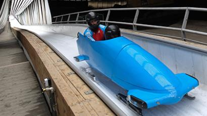 Athletes competing in men's bobsled doubles at the Sanki Sliding Center in Sochi (RIA Novosti / Mikhail Mokrushin)