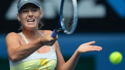 Russia's Maria Sharapova plays a return to compatriot Olga Puchkova in their women's singles match on the first day of the Australian Open (AFP Photo / Greg Wood)