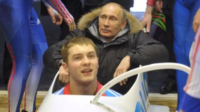 Prime Minister Vladimir Putin, center, went for a ride down a bobsled track during his visit to Paramonovo bobsled and tobogganing center outside Dmitrov in the Moscow Region. (RIA Novosti / Aleksey Nikolskyi)
