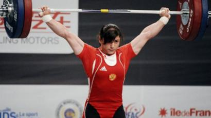 Russia's Svetlana Tsarukaeva competes during the 2011 World Weightlifting Championships' finals in the 63 kg women's weight class on November 8, 2011 in Chessy, eastern suburb of Paris (AFP Photo / Bertrand Guay)