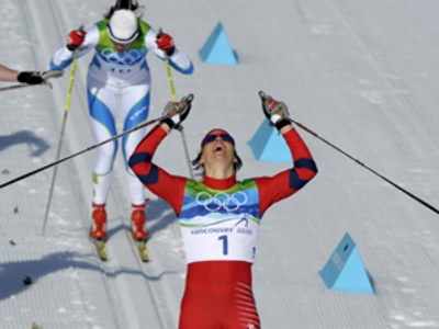 Bjoergen becomes three-time Olympic champ