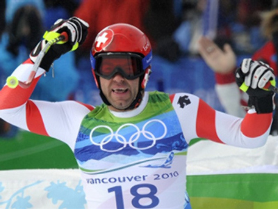 Swiss Didier Defago celebrates victory in men's downhill (AFP Photo DDP / Michael Kappeler)