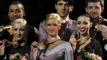 Winners of the overall pairs competition pose with their medals on the podium at the European Figure Skating Championships in Zagreb (Reuters / Antonio Bronic)