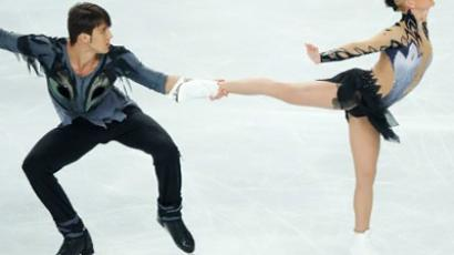 Tatiana Volosozhar and Maxim Trankov (AFP Photo / Leon Neal)