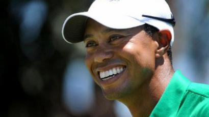 US player Tiger Woods laughs during a practice round for the President's Cup golf event at the Royal Melbourne golf course. (AFP Photo / Wafp photo / William West)