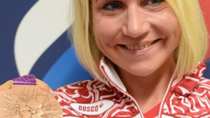 Russian Olga Zabelinskaya, who won a bronze medal in the group cycling competition, after a press conference at the XXX Olympic Games in London (RIA Novosti / Alexander Vilf)