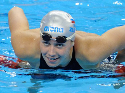 Russia's Anastasia Zueva smiles after she competed in the semi-finals of the women's 50-metre backstroke swimming event in the FINA World Championships at the indoor stadium of the Oriental Sports Center in Shanghai on July 27, 2011 (AFP Photo / Peter Parks)