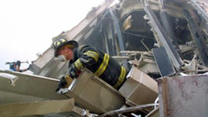Firefighters make their way through the rubble of the World Trade Center 11 September 2001 in New York (AFP Photo / Doug Kanter)